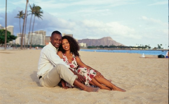 Couple enjoying their honeymoon on a fine white sand beach